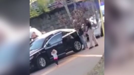Video shows barefoot toddler walking toward police with her hands up as dad gets arrested