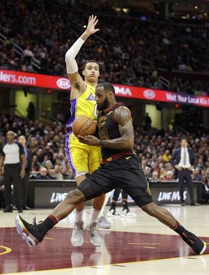 LeBron gets triple-double, Cavs beat Lonzo's Lakers 121-112