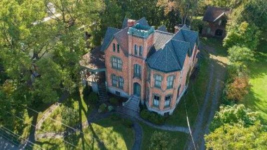 See inside 10-bedroom mansion going for only $50,000