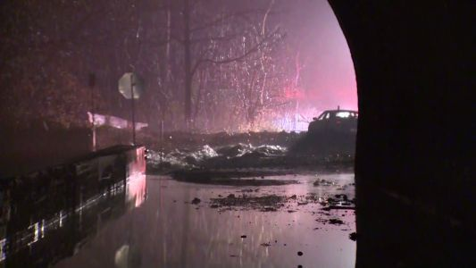Woman rescued from vehicle after large water main break in South Park Township