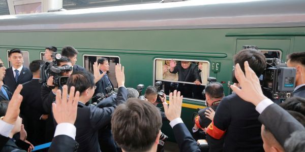 Inside Kim Jong Un's personal train - which is bulletproof, has all-white conference rooms, and its own red carpet ramp