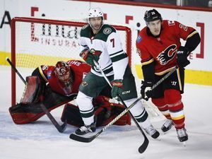 Suter helps rally Wild to 4-2 win over Flames