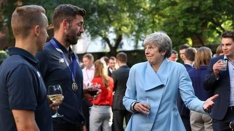 Cricket fans rib PM Theresa May's 'flirting' as she hosts England's World Cup winners