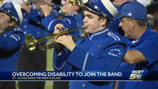 Blind trumpet player overcomes obstacles with help from band of brothers
