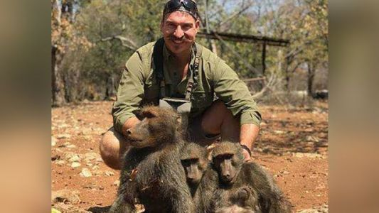 Fish and game commissioner resigns after bragging about killing family of baboons