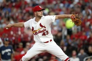 Grandal breaks up Cards' bid for combined no-hitter in 8th