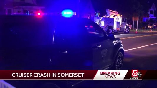 Woman dies in crash involving police cruiser