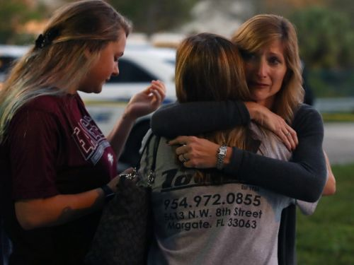 Assistant football coach 'died a hero' jumping between gunman and student in Florida high school shooting
