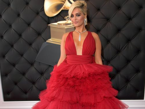 Bebe Rexha turned heads in a voluminous red ball gown at the Grammys after saying some designers refused to dress her