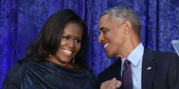 Obama is reportedly feeling competitive after Michelle's smash-hit memoir and sometimes says she used a ghostwriter