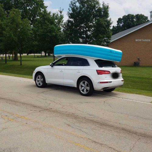 Police: Mother arrested for driving SUV with her two kids in inflatable pool on the roof