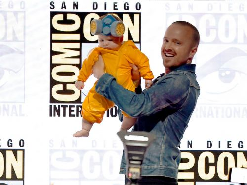 Aaron Paul brought his five-month-old daughter to Comic-Con dressed as his 'Breaking Bad' character and fans are melting