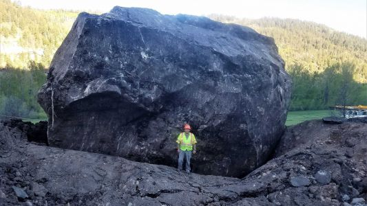 Boulder the size of a building blocks Colorado highway