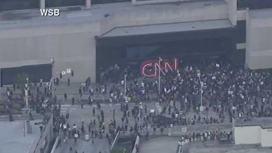 CNN headquarters logo defaced as protesters gather