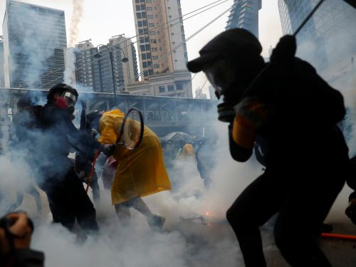 Striking photos show how this weekend's Hong Kong protests escalated into violence with makeshift weapons, water cannons, and tear gas