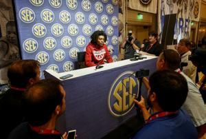 The Latest: Kentucky's Travis brings more experience to team