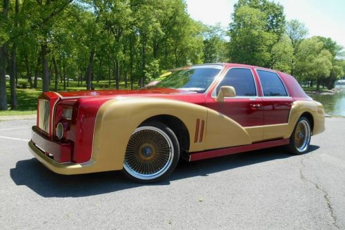 Customizer Gives 1996 Lincoln Town Car an Iron Man Makeover