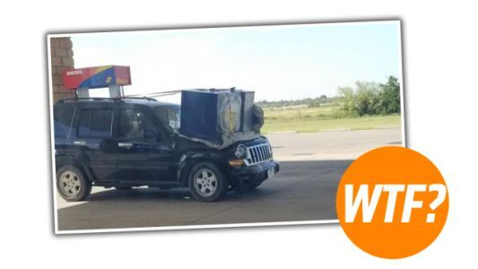 Local Moron Straps Washing Machine To SUV Hood Instead Of Perfectly Good Roof Rack