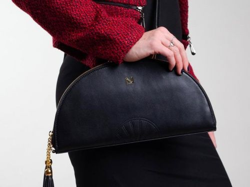 This $225 clutch folds out flat to reveal a clever organizational system for all your essentials - it can also be worn 4 ways