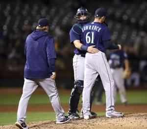 Lowrie drives in 4 to back Manaea, A's hold off Mariners 7-6