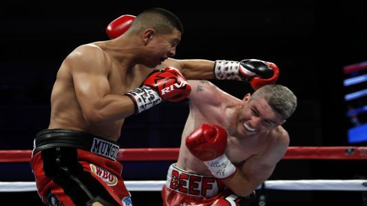 Jaime Munguia wins after 12-round marathon with Liam Smith
