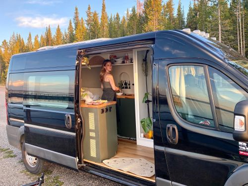 A couple converted a $20,000 Ram ProMaster van into a tiny house while in lockdown, and they are now road tripping across the country - take a look inside