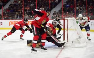 Hoffman's point streak at 16 games, Florida top Senators 7-5