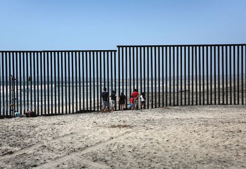 There's a beach separating the US and Mexico where families meet on either side of towering border walls - see what it looks like
