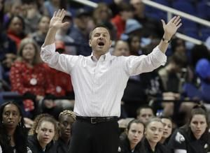 No. 1 seed Louisville begins NCAAs minus coach Jeff Walz