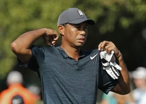 No sweat: Woods changes shirt and game to stay in mix at PGA