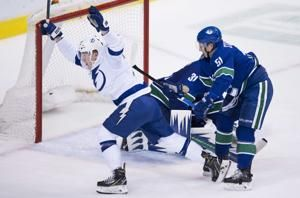 Kucherov, Lightning beat Canucks 5-2 in fight-filled game