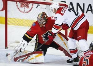 Backlund scores in OT to give Flames 3-2 win over Hurricanes