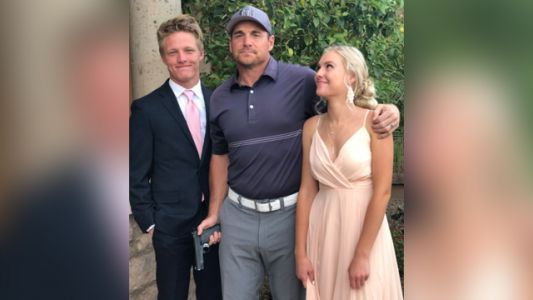 Former NFL player says posing with gun in daughter's prom photo was a 'joke'