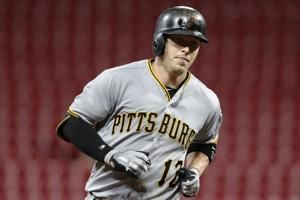 Rodriguez, Marte power Pirates past Reds 12-1 after delay