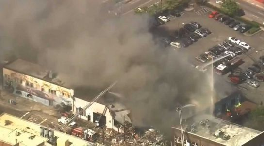1 dead, firefighter injured after gas leak explosion, fire levels building, officials say