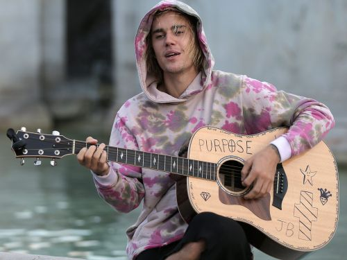 Justin Bieber goes to church and believes in Jesus, but says he doesn't consider himself 'religious'