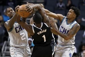 Harris, Jordan lead Nets past Hornets, 111-104
