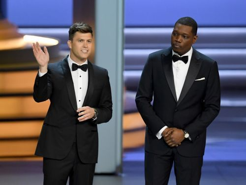 Emmy hosts Colin Jost and Michael Che go after 'Roseanne,' Netflix, and network executives in the opening monologue