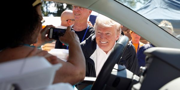 Trump asks about conditions in area near one of his golf courses while surveying Hurricane Florence damage in North Carolina