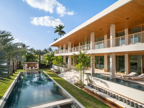 An architect who designs homes for the wealthy built a Miami Beach mansion on a 13-foot platform to protect it from the risk of rising ocean levels. Here's a look inside the $27 million home