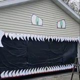 We Can't Stop Watching This DIY Halloween Monster Garage Decoration