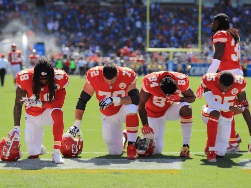The NFL is citing an obscure operations manual that says players 'should' stand during the anthem