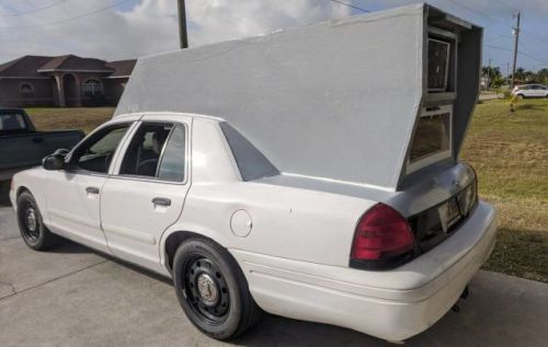 Someone Turned This Ford Crown Victoria Police Cruiser Into A Camper And It is Glorious