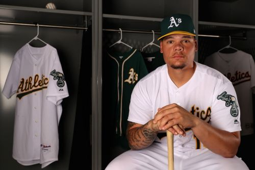 A's catcher becomes first MLB player to kneel during national anthem