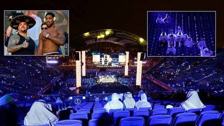 Raining on their parade: Ruiz vs Joshua venue in Saudi hit by downpour amid fears of disruption to blockbuster boxing event
