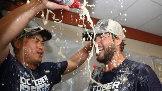 Dodgers' subdued NL West celebration reflects their lofty goals, previous accomplishments