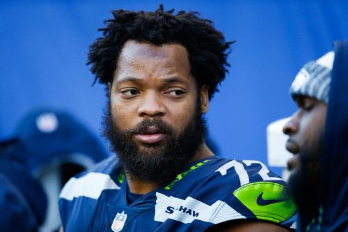 NFL star Michael Bennett indicted, accused of injuring elderly paraplegic woman