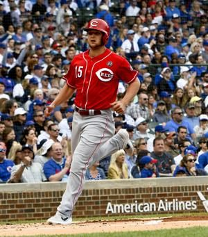 Senzel helps Reds pound Cubs 10-2