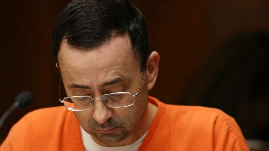 Former USA Gymastics doctor Larry Nassar sentenced to 60 years in child pornography case
