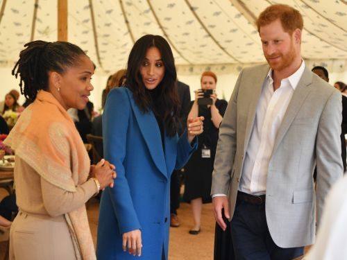Prince Harry got caught 'stealing' food at Meghan Markle's charity cookbook launch, and he shot cameras a guilty smile